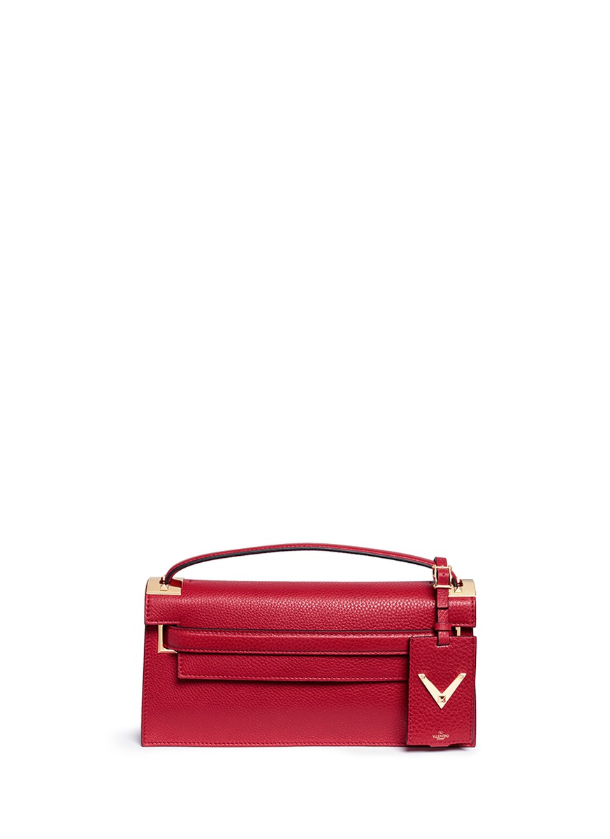 My Rockstud pebbled leather clutch bag by Valentino