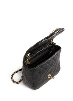 Mini crystal lock quilted leather bag
