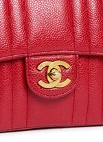Quilted caviar leather mini flap bag