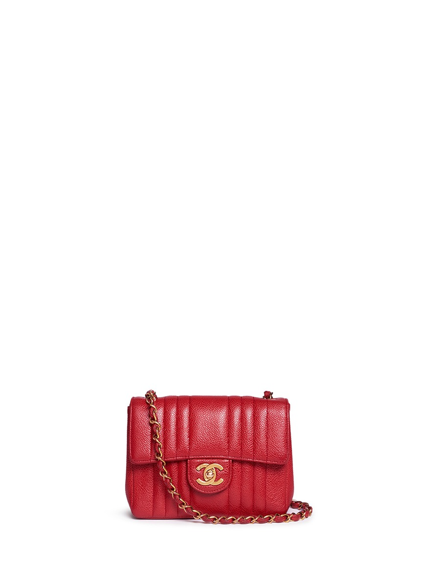 Quilted caviar leather mini flap bag by Vintage Chanel