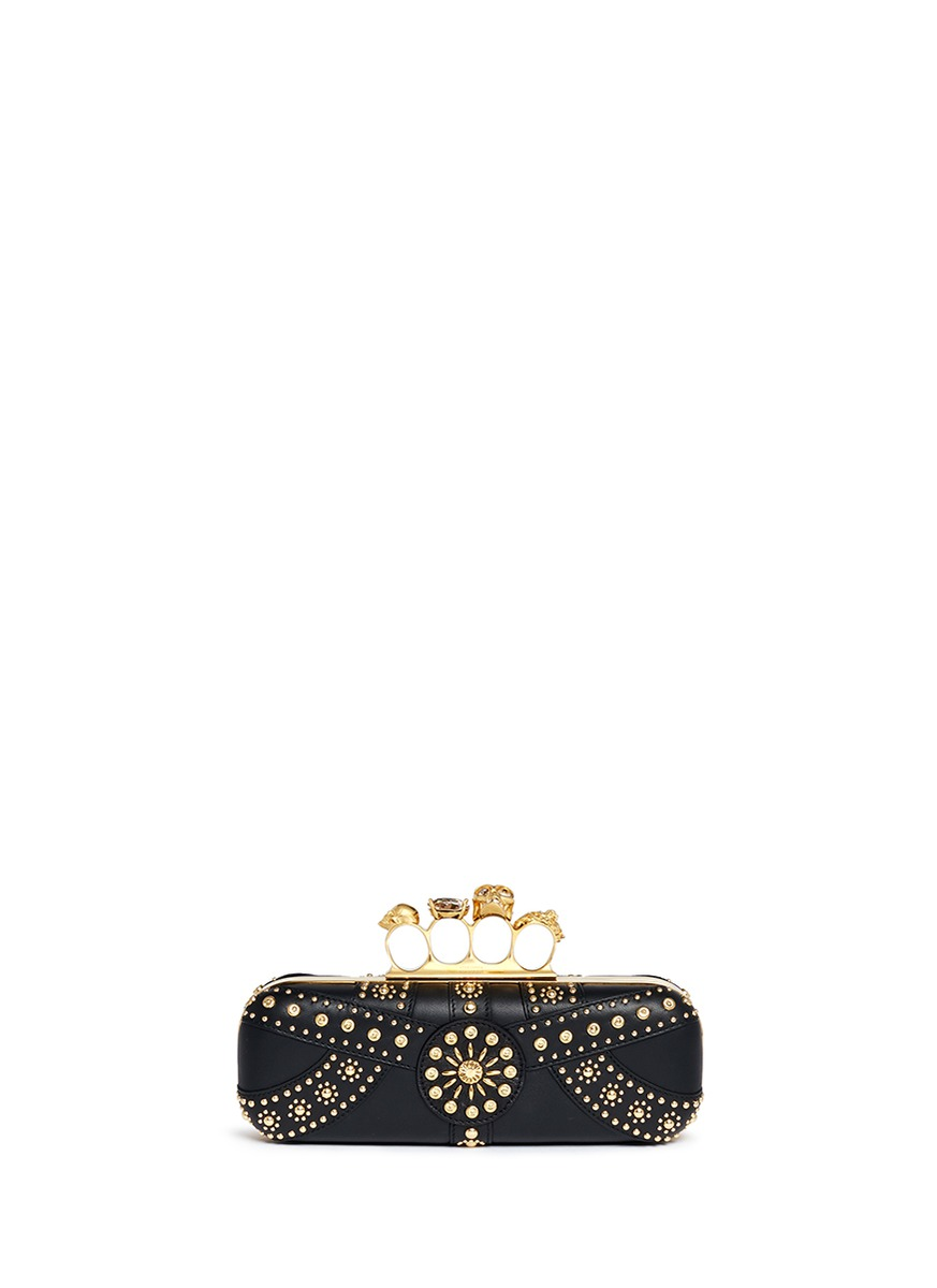 Stud skull leather knuckle clutch by Alexander McQueen