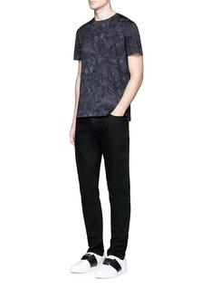 Valentino 'Rockstud Untitled 06 Noir' raw jeans