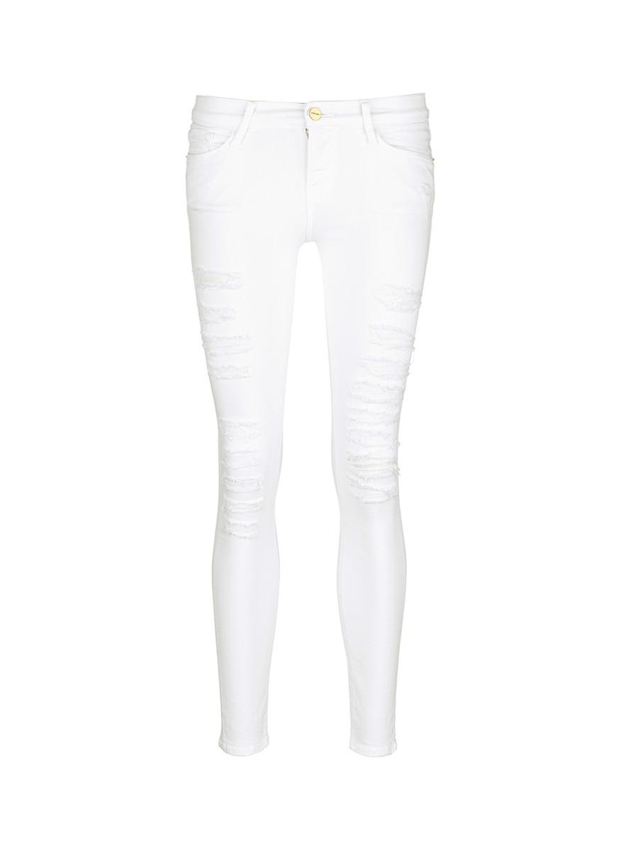 Le Skinny de Jeanne ripped jeans by Frame Denim