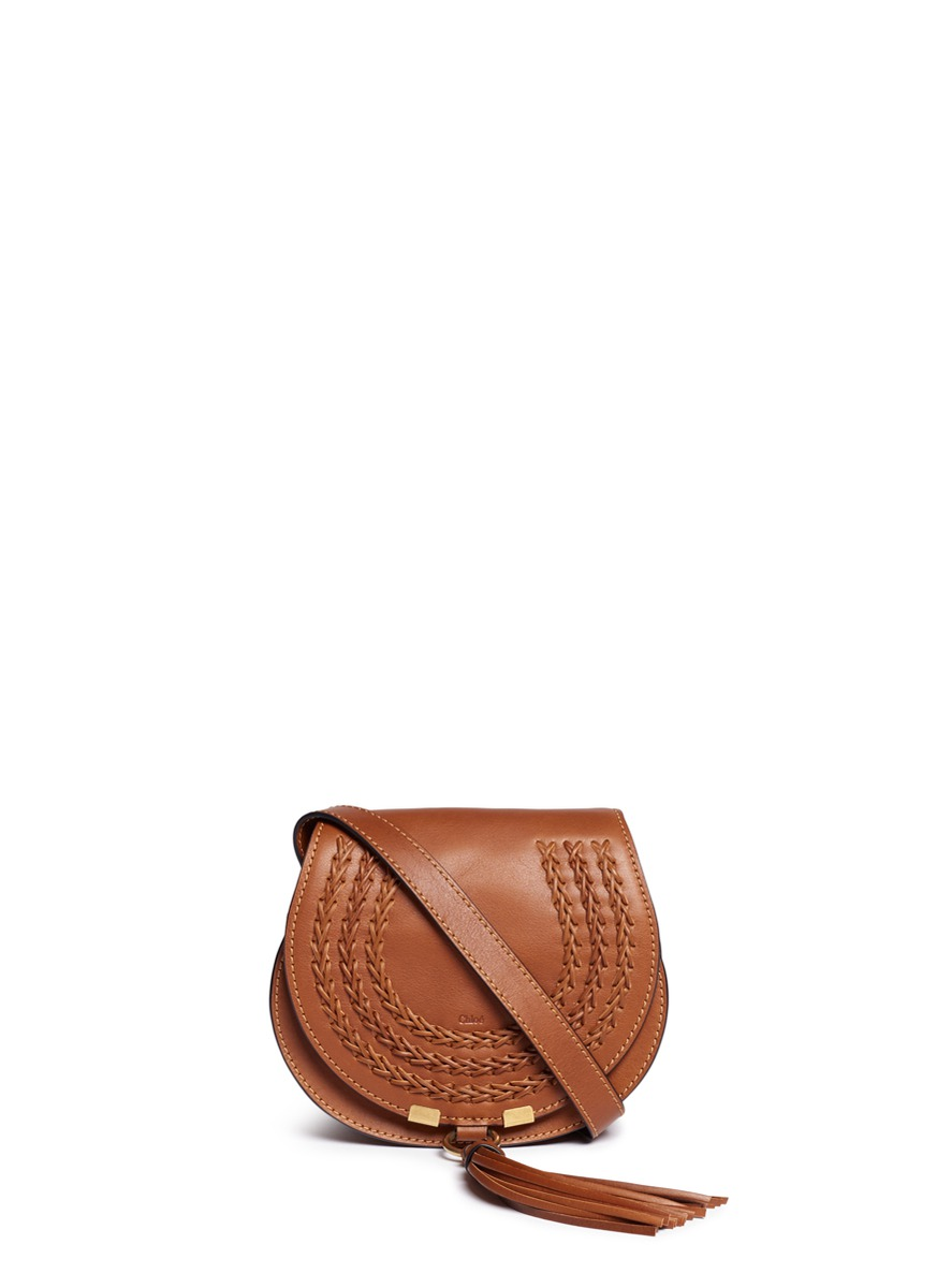 Marcie mini tassel braided leather saddle bag by Chloé