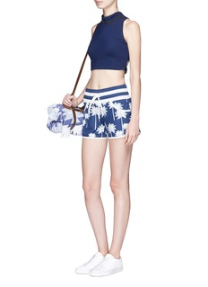 Perfect Moment Palm tree print resort shorts
