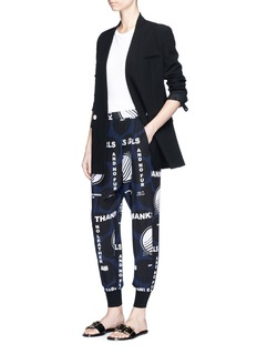 Stella McCartney 'Joey' polka dot slogan print silk track pants