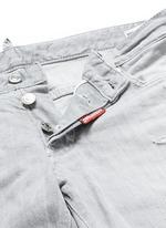 Slim fit rip and repair jeans