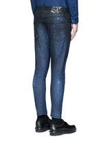 'Sexy Twist' rip and repair slim fit jeans