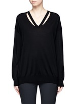 Cut out V-neck Merino wool sweater