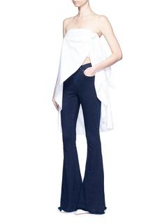 NICHOLASWashed denim flared jeans