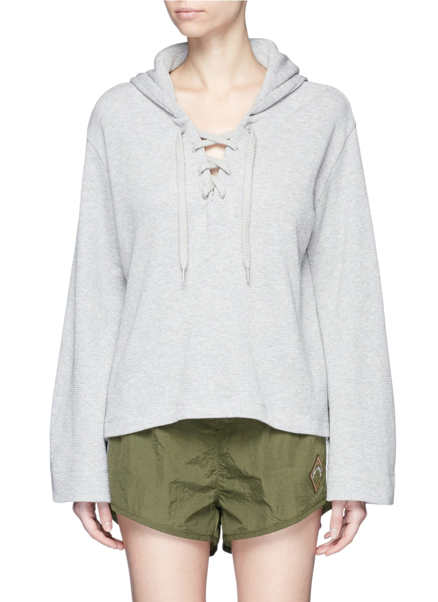 Oxford bell sleeve lace-up hoodie by The Upside