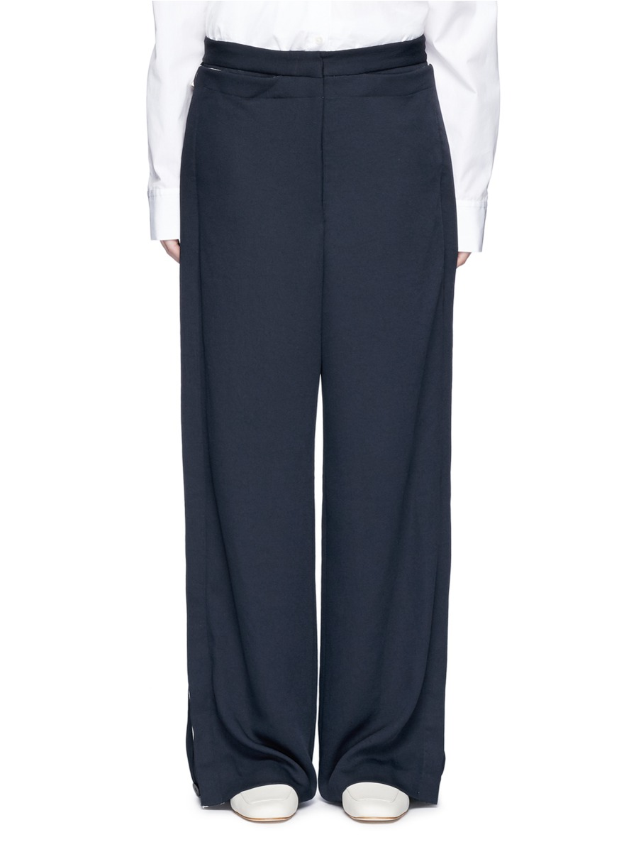 Layered whitewash wide leg pants by Dion Lee