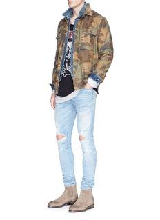 AmiriCamouflage print stud distressed field jacket