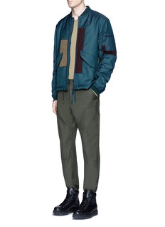 OAMCPatchwork padded bomber jacket