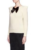 Sequin bow appliqué peaked shoulder sweater