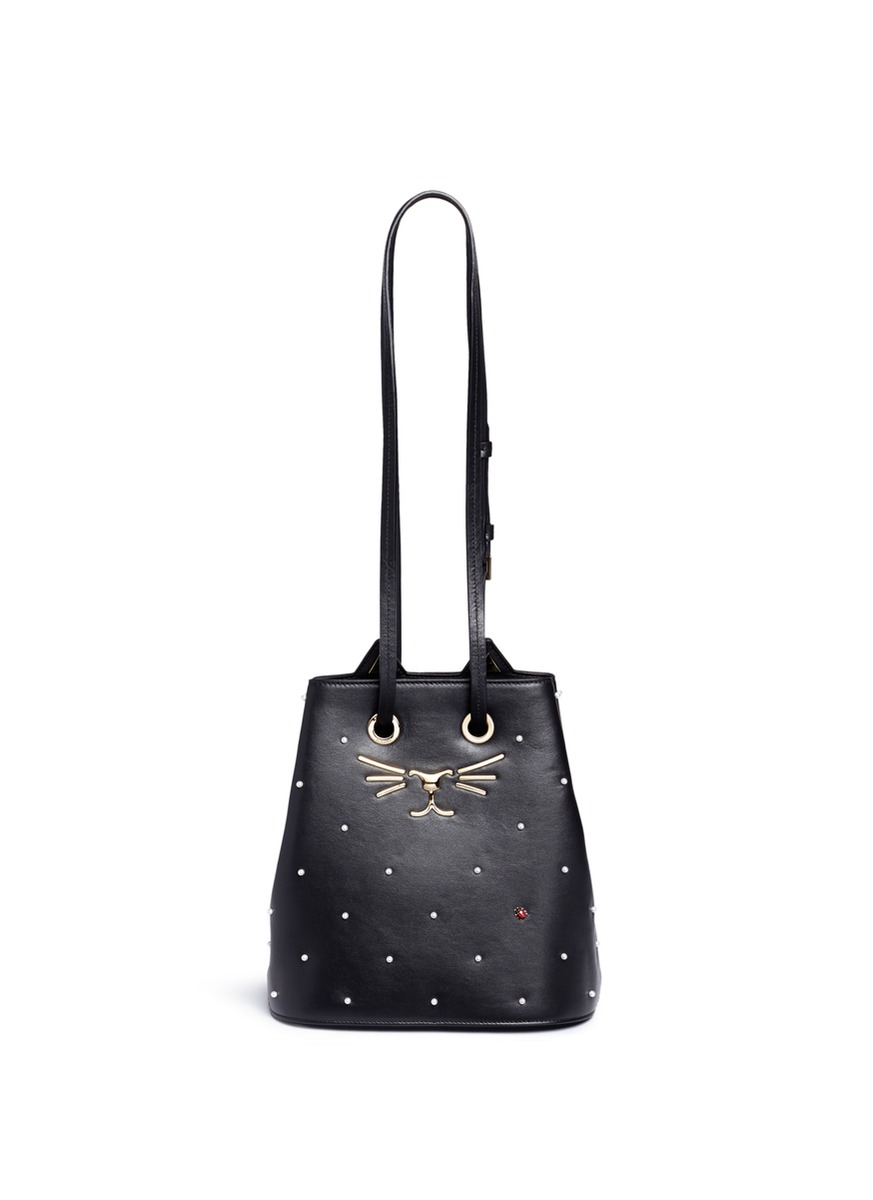Feline pearl and ladybug embellished leather bucket bag by Charlotte Olympia