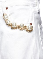 Faux pearl chain distressed cutout jeans