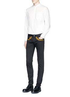 Johnundercover Decorative embroidered slim fit pants