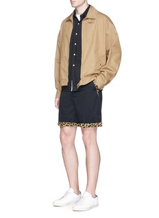 Johnundercover Leopard print trim wool twill shorts