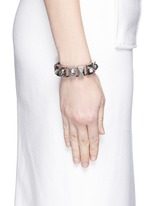 Skull and crystal metal loop leather bracelet