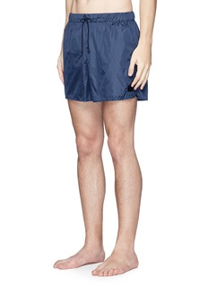 Acne Studios 'Perry' face patch swim shorts