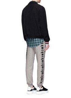 McQ Alexander McQueenLogo embroidered French terry sweatpants