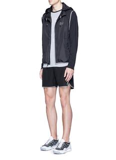 The Upside'Night Runner' retractable hood zip vest