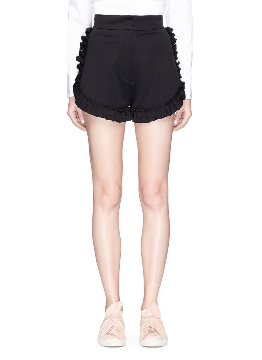 Ruffle trim stretch twill shorts by Shushu/Tong