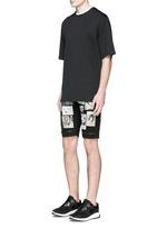 Art patchwork appliqué denim shorts