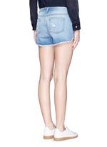 Distressed cutoff denim shorts