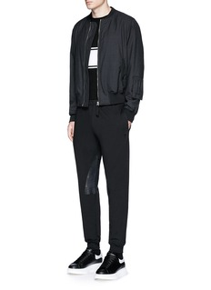 Alexander McQueen Perforated leather patch jogging pants