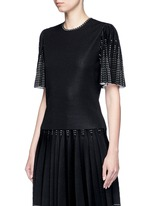 Geometric jacquard pleated sleeve knit top