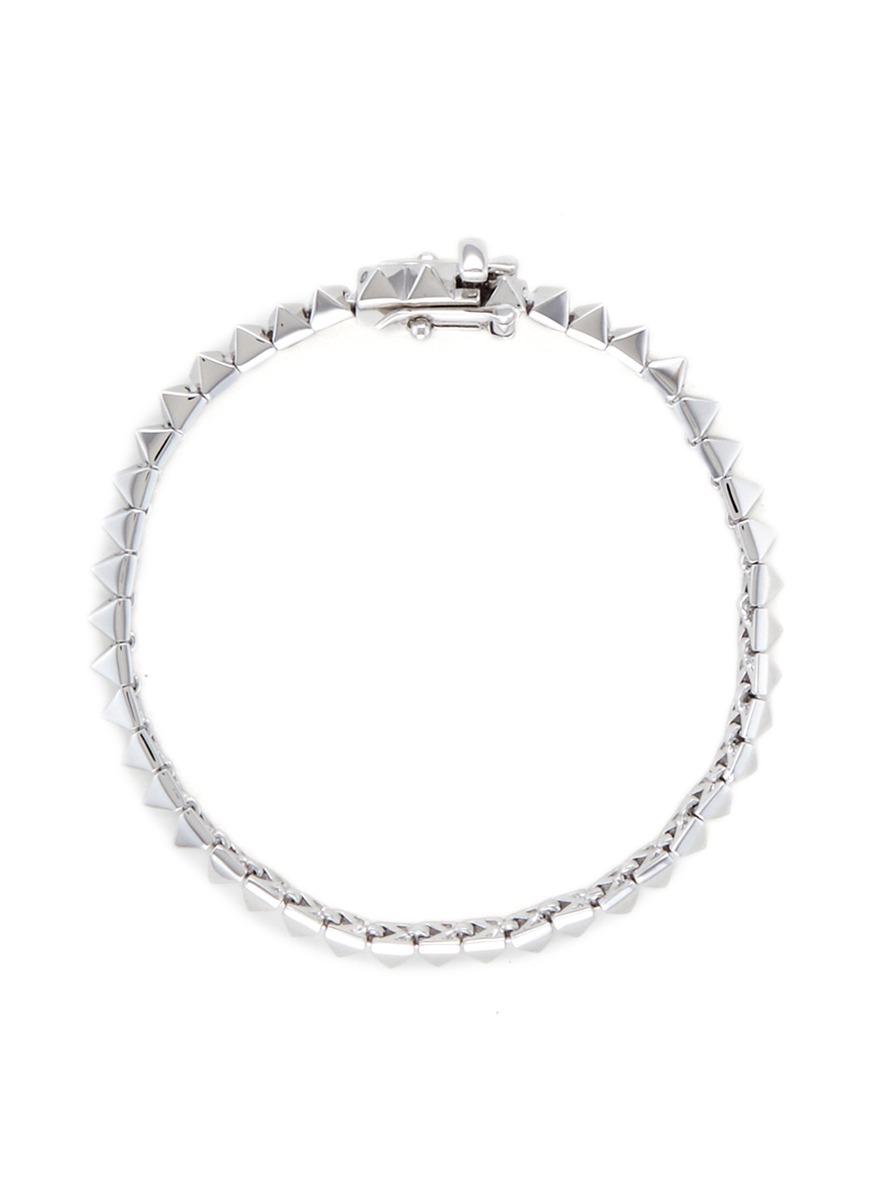 Pyramid stud tennis bracelet by Eddie Borgo