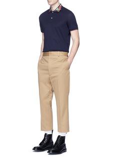 GucciDragon embroidered piqué polo shirt
