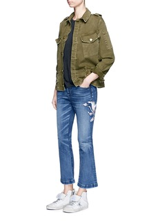 Tortoise Crane embroidered flare jeans