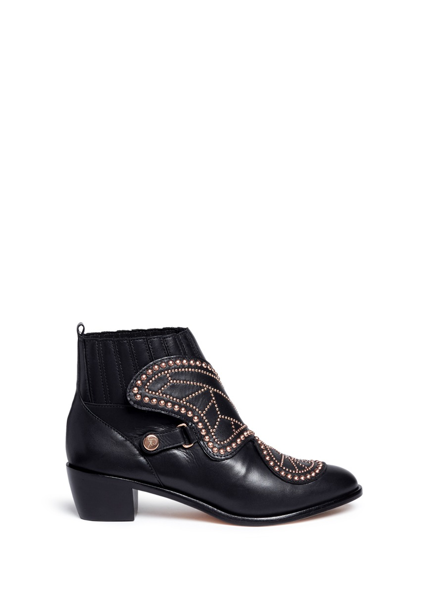 Karina butterfly stud embellished leather boots by Sophia Webster