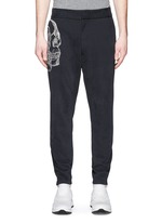 Skull sketch embroidery jogging pants