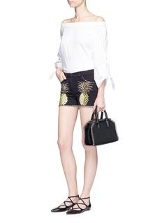 GiambaPineapple print frayed denim shorts