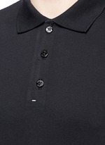 Raw edge cotton piqué polo shirt