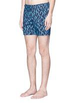 Mid length arrow print swim shorts