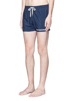 Mid length embroidered swim shorts