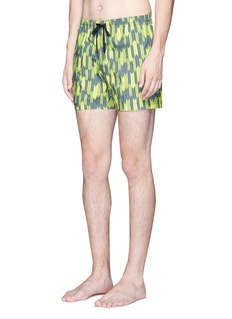 DANWARD Mid length arrow print swim shorts