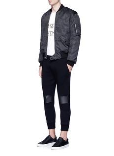 Neil BarrettEco leather knee cropped biker jogging pants