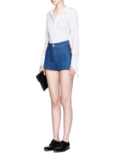 ALEXANDER MCQUEENLace-up side mini denim shorts