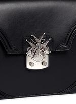 Crystal pavé starburst medallion leather satchel