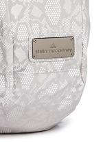 Reflective snakeskin print running backpack