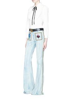 GucciStud floral patch flared denim pants