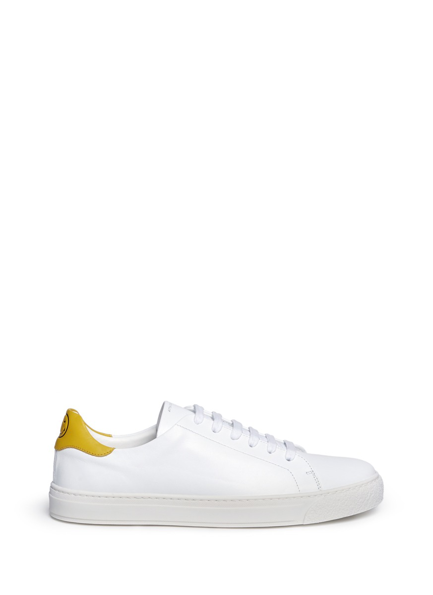 Wink embossed leather sneakers by Anya Hindmarch
