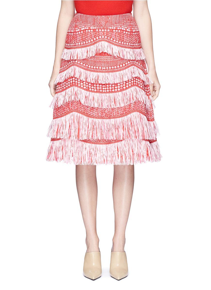 Tassel fringe raffia skirt by Angel Chen