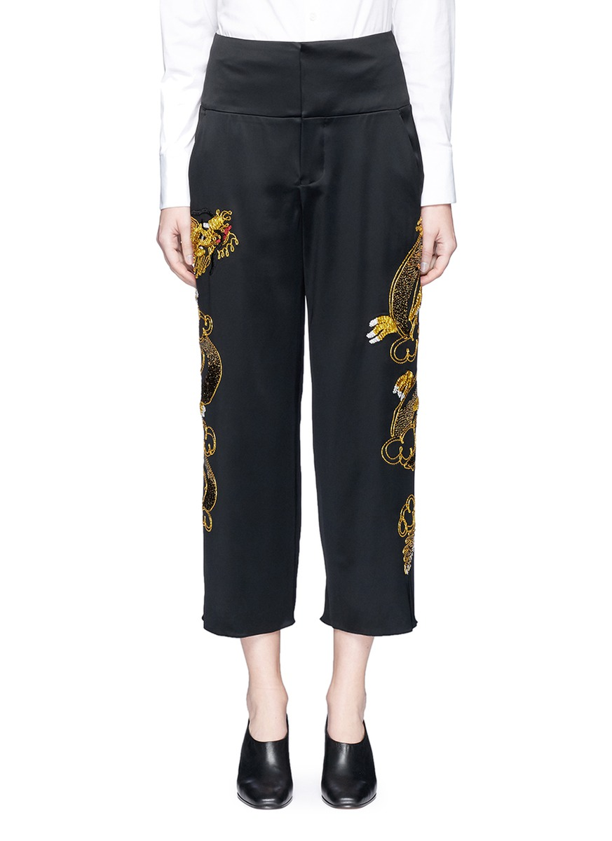 Sequin dragon embroidery cropped satin pants by Ms MIN